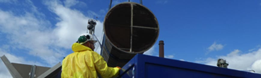 A typical exchanger being removed from the ultrasonic bath for inspection and rinsing.